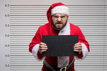 悪いサンタクロースがあなたを指し示し、コンセプトクリスマス