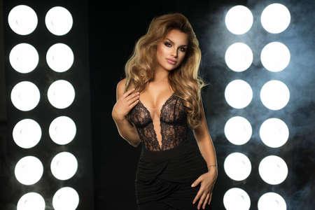 Portrait of beauty blonde woman in dark room