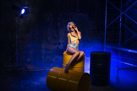 Sexy blonde woman with photo light flash Standard-Bild - 108857684