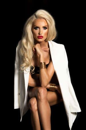 Sexy blonde woman in white jacket Standard-Bild - 108857699