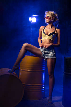 Sexy blonde woman with photo light flash Standard-Bild - 108857701
