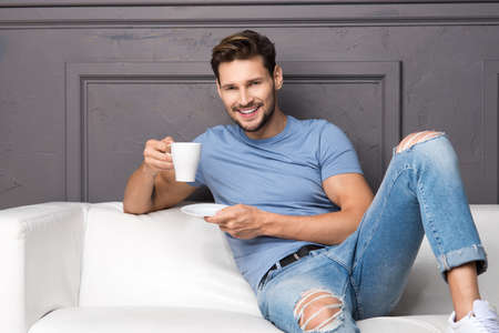 Handsome man with cup of coffee Standard-Bild - 108857708