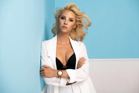 Portrait of smiling beautiful blonde girl  in white suits Standard-Bild - 108857710