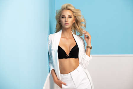 Portrait of smiling beautiful blonde girl  in white suits Standard-Bild - 108857712