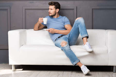 Handsome man with cup of coffee Standard-Bild - 108857713