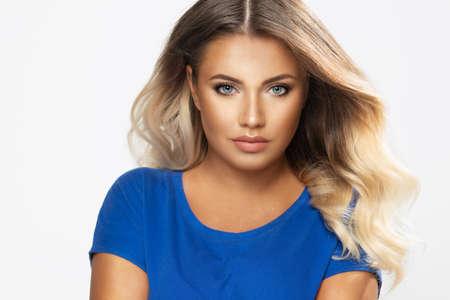 Sensual beautiful blonde woman posing. Girl with long curly hair. Standard-Bild - 108857750