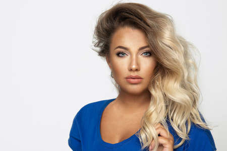 Sensual beautiful blonde woman posing. Girl with long curly hair. Standard-Bild - 108857751