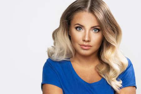 Sensual beautiful blonde woman posing. Girl with long curly hair. Standard-Bild - 108857758