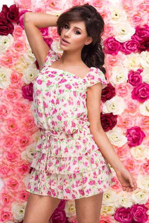 Beauty happy model girl with flowers Standard-Bild - 109256677