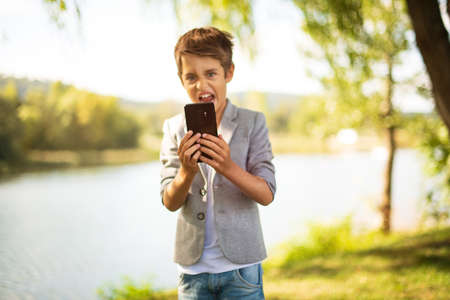 Happy child make photo Standard-Bild - 110292576