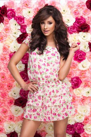 Beauty happy model girl with flowers Standard-Bild - 109613071