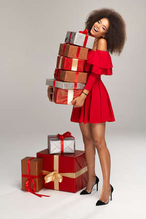 Female model wear red dress keeps gifts 免版税图像