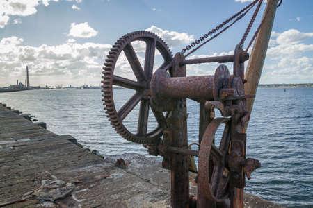 The old crane in Poolberg Lighthouse, Dublin. Ireland Banco de Imagens