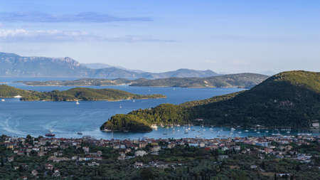 Panoramic view of Nidri town, Lefkada, Greece. High angle view of Nydri port and small islands.