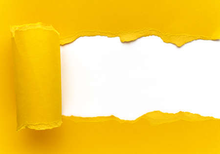 Yellow torn paper. Square shaped hole with white background. Stock Photo