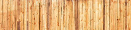 Wide wooden wall with vertical boards texture. Stock Photo