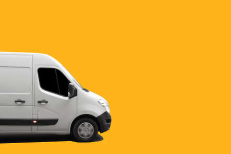 Side view of white delivery truck on yellow background. Delivery concept Imagens