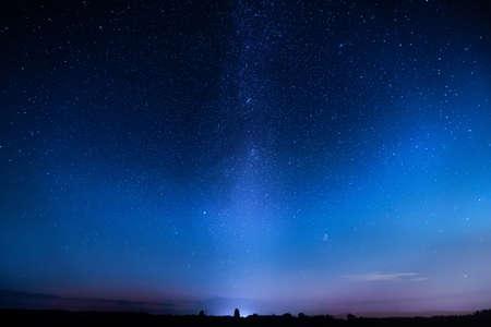 Blue starry sky. Night colorful landscape. Sky with many stars at night.
