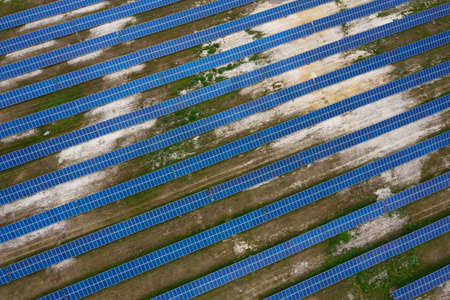 Solar battery station. View from drone solar panels in the field. Alternative types of energy.