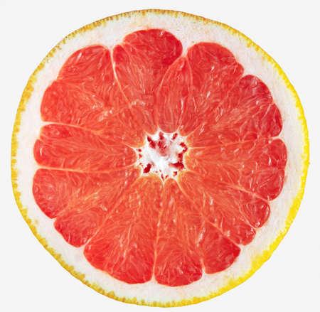 Grapefruit slice isolated on white. Fresh sliced red grapefruit. Stock Photo