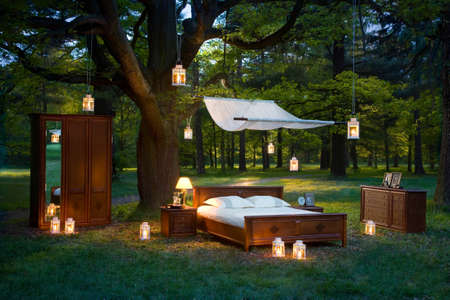 good mood: bed in forest - concept of good sleep