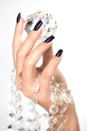 manicure nails: Beautiful woman hands with big diamond