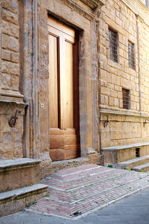 valdorcia: Wooden door in Tuscany.Pienza, Italy