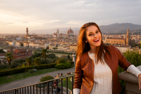 Beautiful smiling woman with background of Florence, Tuscany. photo