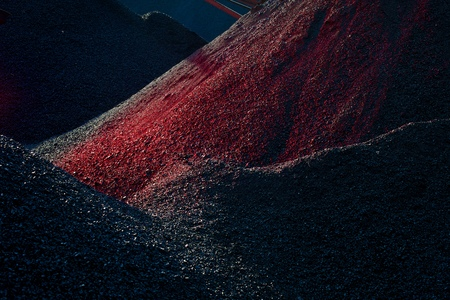 heaps: Heaps of coal in the red light Stock Photo