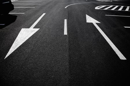 Arrow sign as road markings on a street Stockfoto