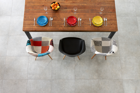 Dining wooden table and color porcelain plates photo