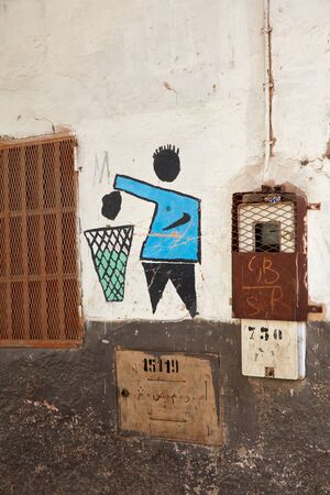 throwing: Symbol throwing trash, painted on the wall, Morocco