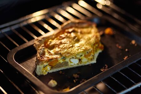 Piece of tart baked in the oven. Small depth of focus.