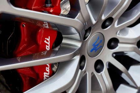 Warsaw / Poland - 01.17.2018 : Maserati aluminium wheel. Close-up on red brake calipers.