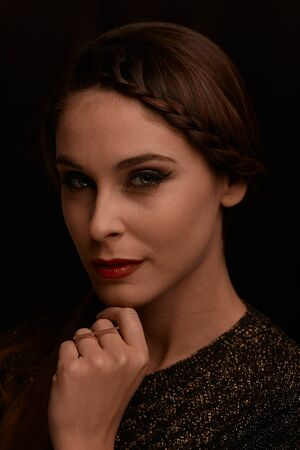 A portrait of a beautiful and sensual woman in the dark. Lighting in Rembrandt style.