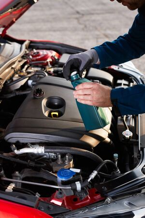 Checking and refilling the oil level in a modern car