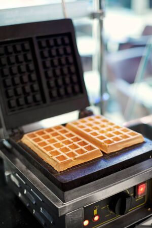 Freshly baked waffles in a professional waffle machine
