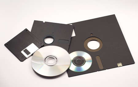 Several floppy disks and CD-ROMs