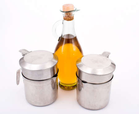 Olive oil and oilcans