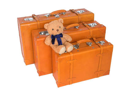leather suitcases and teddy bear