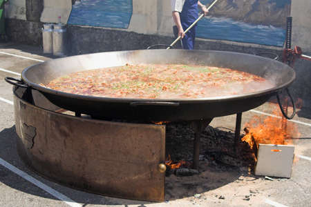 cooking giant paella for a school picnic party, Spain Stock Photo