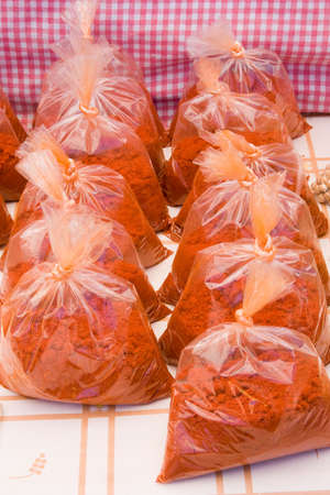 paprika powder in bags at the market Stock Photo