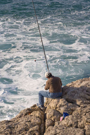coast line: a fisher man and his fishing rod