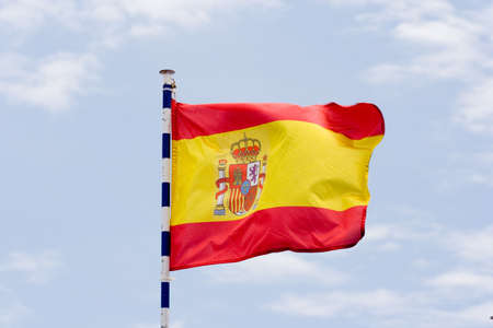 spanish flag moved by the wind photo