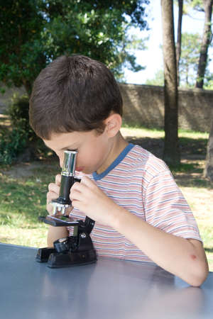 schoolboy with microscope