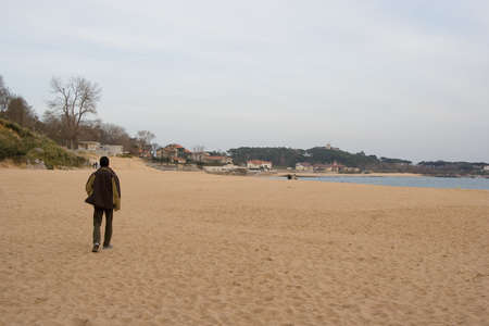 teenager walking alone at the beach, Santander Stock Photo - 2790463