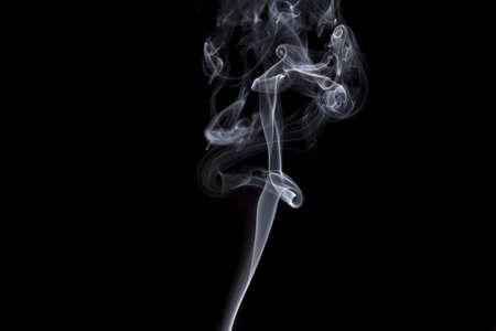 Smoke volutes on a pure black background  Stock fotó