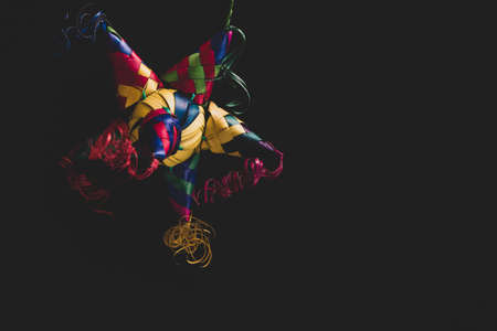 Portrait of a Colorful Mexican Pinata on a black background