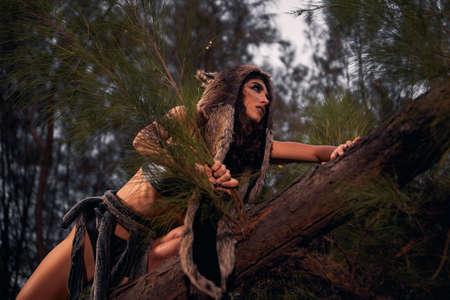wolf woman in forest. cosplay costume Standard-Bild
