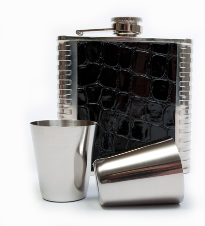 Hip flask and cups with white background Stock Photo - 16603193